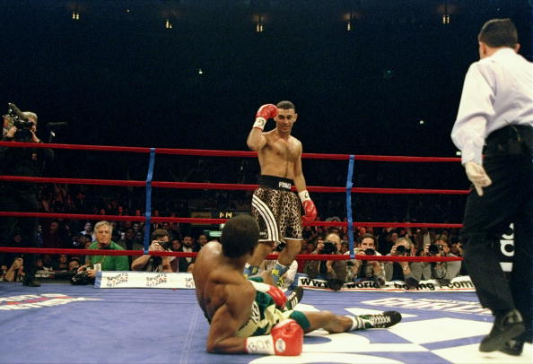 Prince Naseem Hamed stands over Kevin Kelley