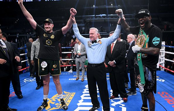 LOS ANGELES, CA - DECEMBER 01: Tyson Fury and Deontay Wilder pose for a photo with referee Jack Reiss after fighting to a draw during the WBC Heavyweight Champioinship at Staples Center on December 1, 2018 in Los Angeles, California. (Photo by Harry How/Getty Images)