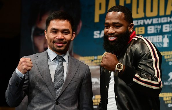 NEW YORK, NY - NOVEMBER 19: Manny Pacquiao (L) and Adrien Broner face off during a press conference at Gotham Hall in