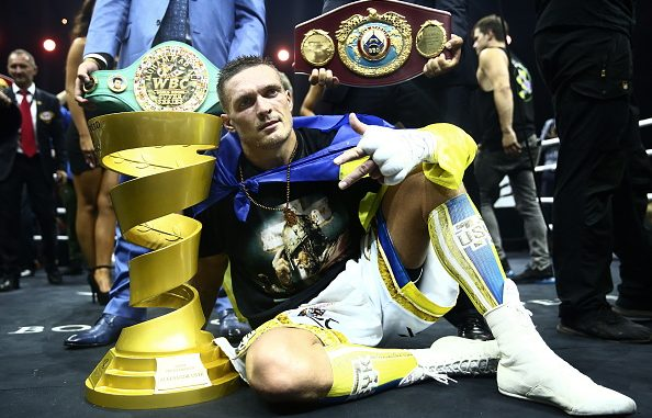 MOSCOW, RUSSIA - JULY 21, 2018: WBC/WBO champion Oleksandr Usyk (front) of Ukraine, poses with the Muhammad Ali Trophy as he wins his WBSS (World Boxing Super Series) cruiserweight final bout against WBA/IBF champion Murat Gassiev of Russia, at Moscow's Olympiyskiy Arena. Valery Sharifulin/TASS (Photo by Valery SharifulinTASS via Getty Images)