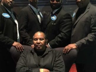 "John ""Pops"" Arthur, seated, center. In back, left to right, Lamon Brewster, Chris Byrd, James, Ray Mercer."