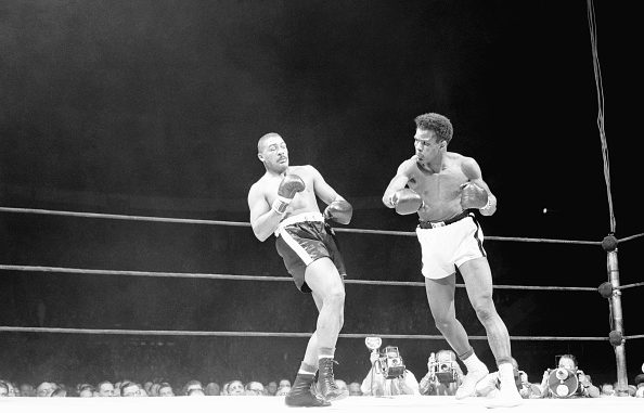 "(Original Caption) Big Bob Baker (left) leans back to evade the hurricane of blows from Tommy ""Hurricane"" Jackson in the third round of their heavyweight go at the Garden tonight. Jackson won by a very close decision over his Pittsburgh opponent, who is regarded as the number two contender for the crown."