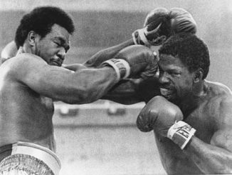 Denver heavyweight Ron Lyle, right, grazes Heavyweight Champion George Foreman with a straight right in the fourth round of their title fight at Las Vegas, Nev., Saturday night, Jan. 26, 1976. Foreman won the world heavyweight boxing championship in the fifth round. (AP Photo)