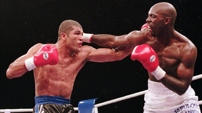 Frank Liles, USA, right, punches Brazil's Mauricio Amaral in their WBA super-middleweight worldchampionship fight in Stuttgart, Saturday, Dec.9, 1995. Liles won the fight by points and defended the titel. (AP Photo/Thomas Kienzle)
